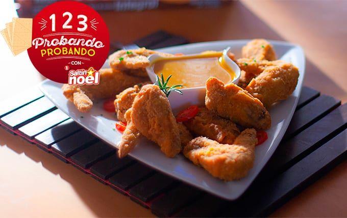 Alitas de pollo apanadas